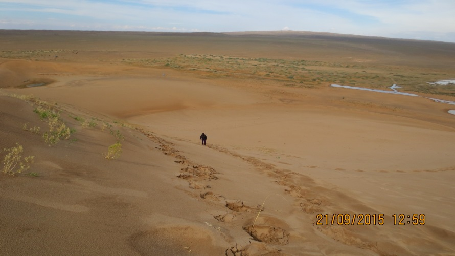 Climbing up the sand dunes .. they are small hills !