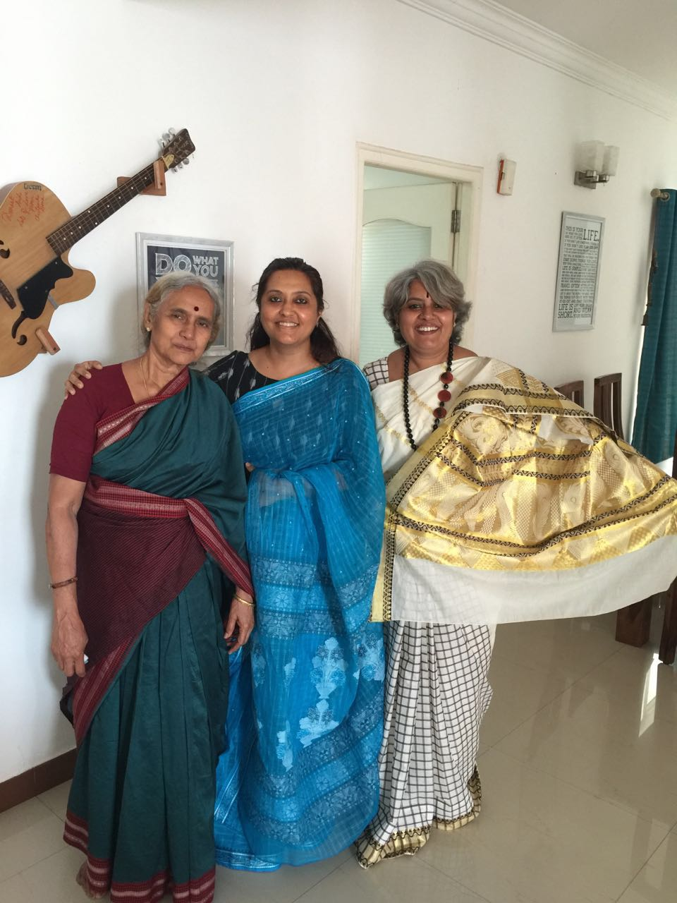 Amma is wearing her favourite green sari that is from Kumaran stores. Pushpa is a blue Bengali taint and I am in the off-white Kasavu.