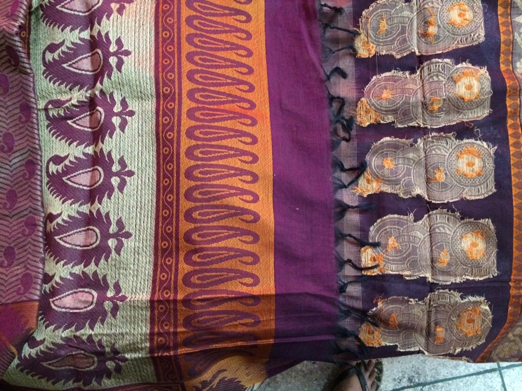 This is the backside of the Pallu of two saris. The one on the left is a power loom made sari and the one on the right is a hand woven sari. The power loom product doesn't have a break in the threads, while the hand woven one has breaks for each motif. Effort and sheer artistry.