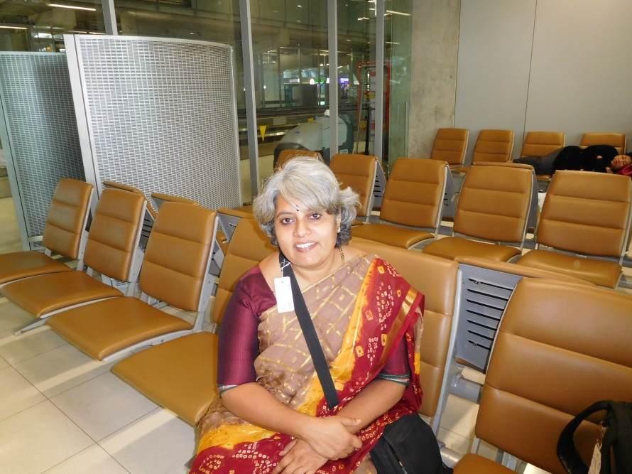 The first time that I am taking an international flight in a sari ... usually I would wear pants or a salwar suit. But this was fun.
