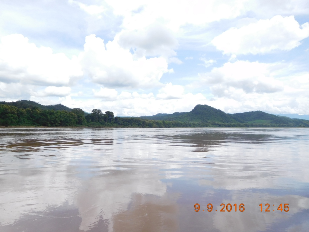 The clouds reflected in the Mekong river ... on our way back.