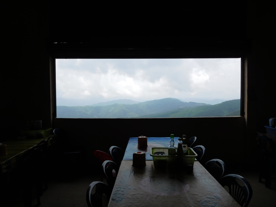 This restaurant is at a place called Pho Kham ... doesn't the window look like a painting thats framed ?