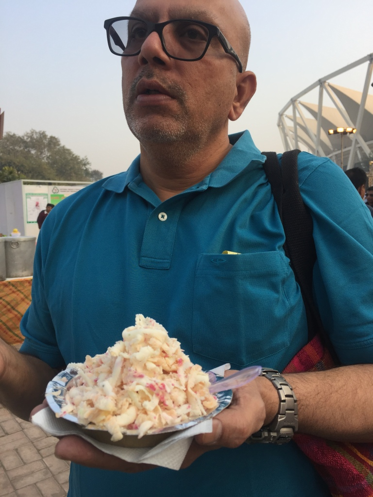 Krishnan with his plate of ice cream ... he was checking closely to see if they used Papaya, a fruit he doesn't like :)